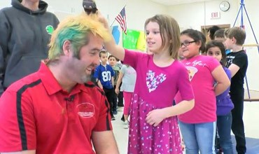 Students stand in line to shave teacher's head