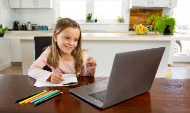 Girl looking at laptop computer at home