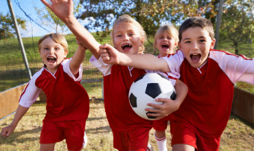 Students with soccer ball