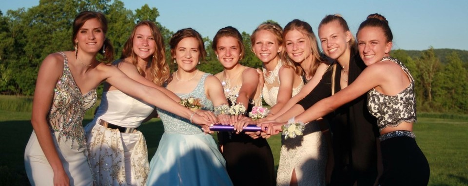 Girls Track Team in their Prom Dresses
