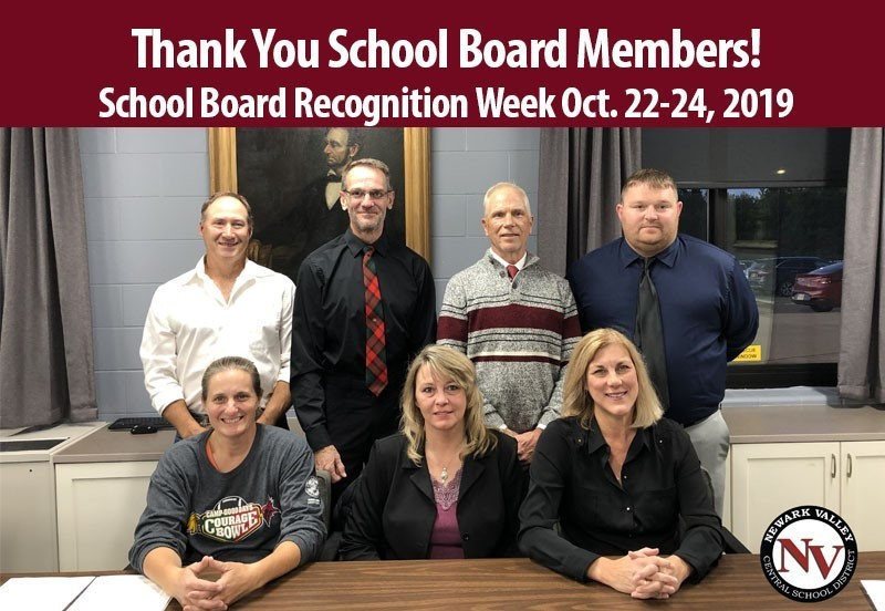 Seven school board members in conference room