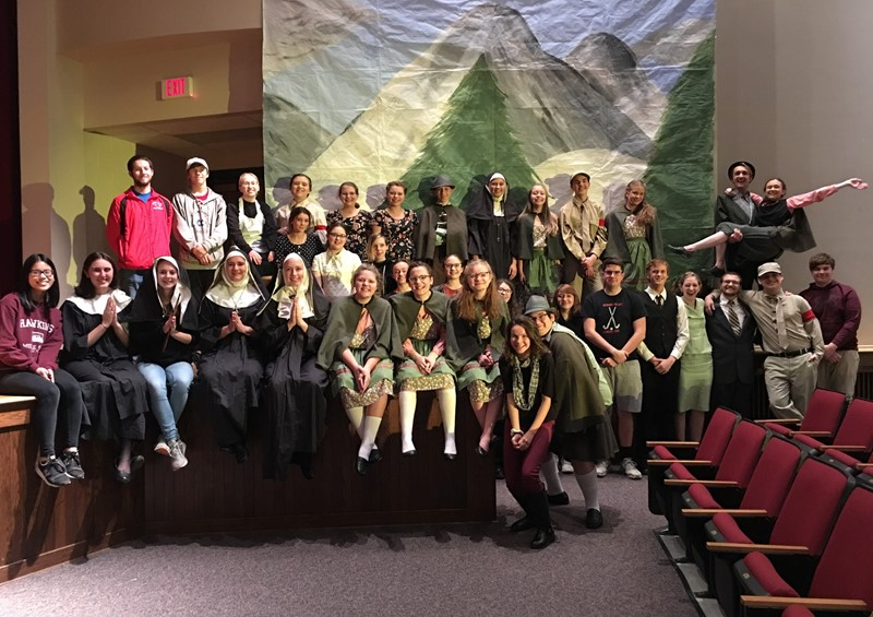 Cast and crew of Sound of Music in auditorium
