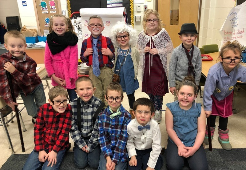 Group of kids dressed up like old people