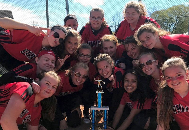 Girls varsity softball team with trophy
