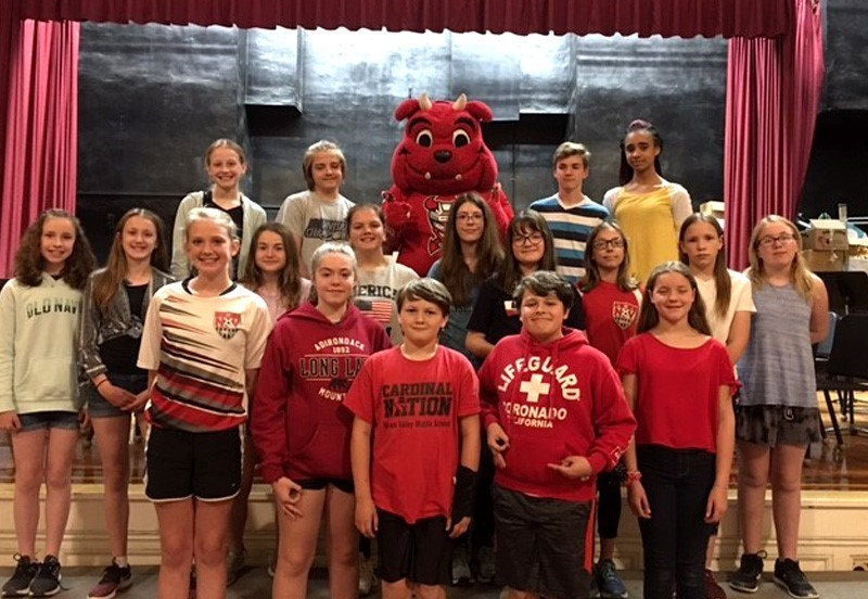Group of students and the Binghamton Devils Hockey Mascot