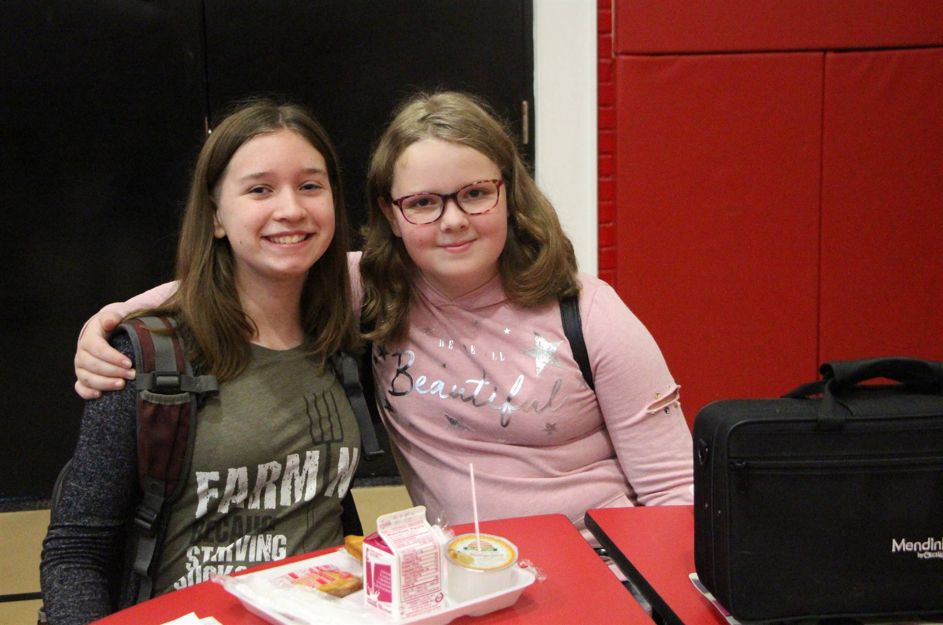 Two girls in cafeteria