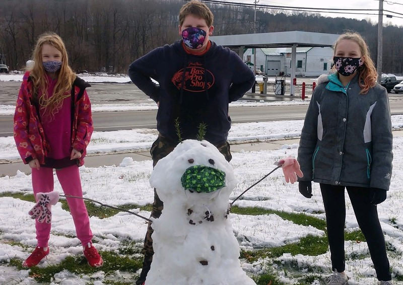 Three students with homemade snowman
