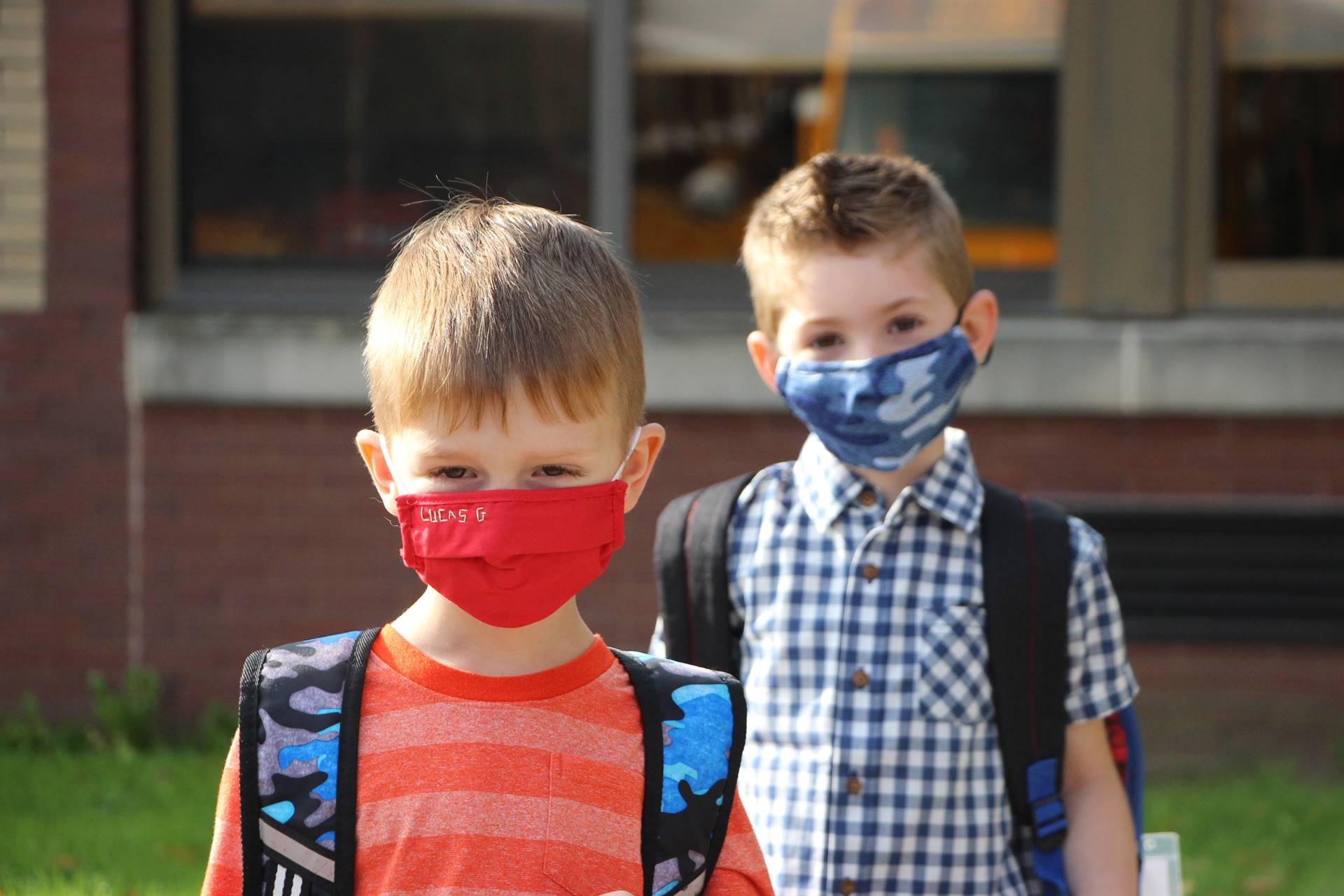 Two boys in facemasks outside