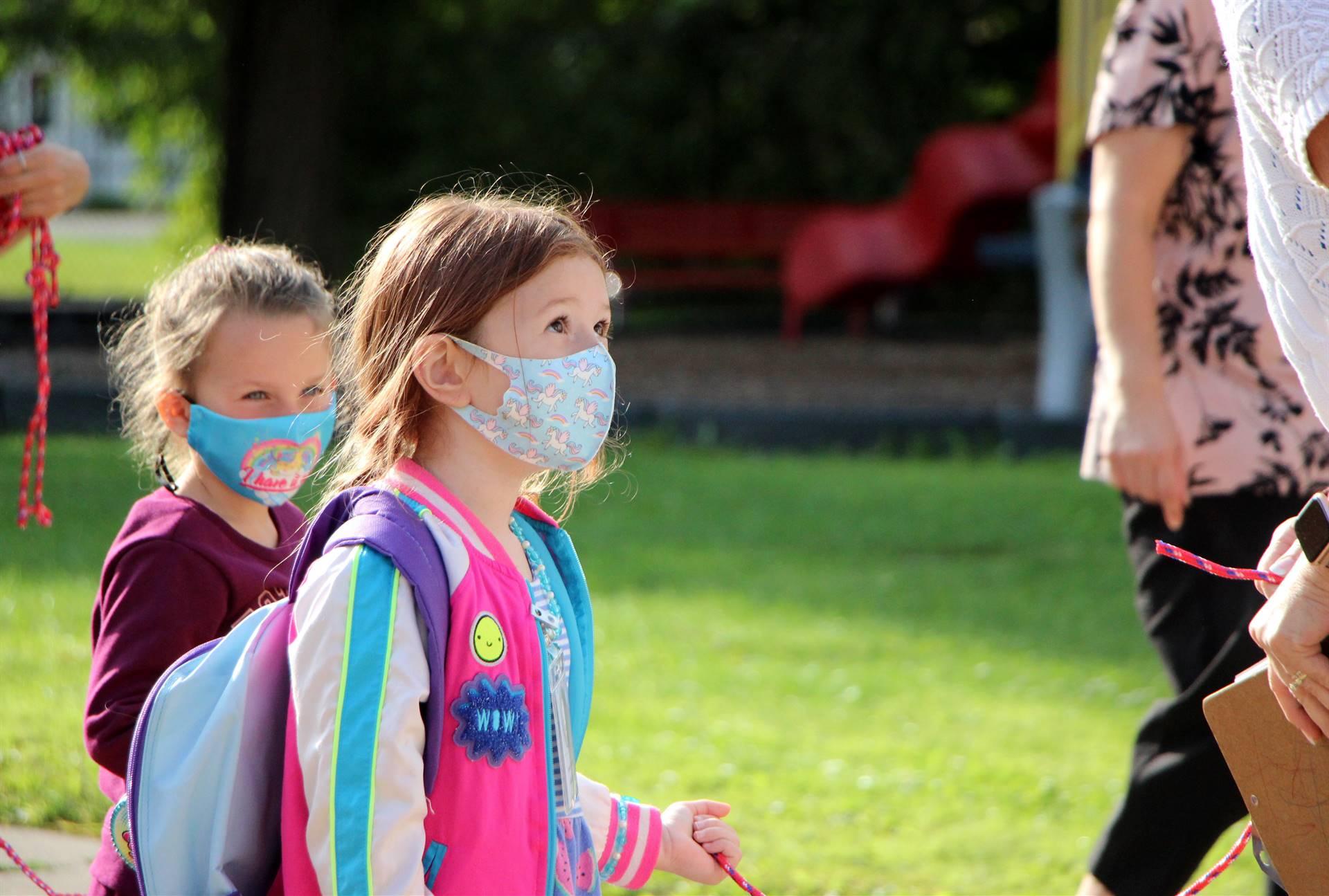 girl in facemask outside