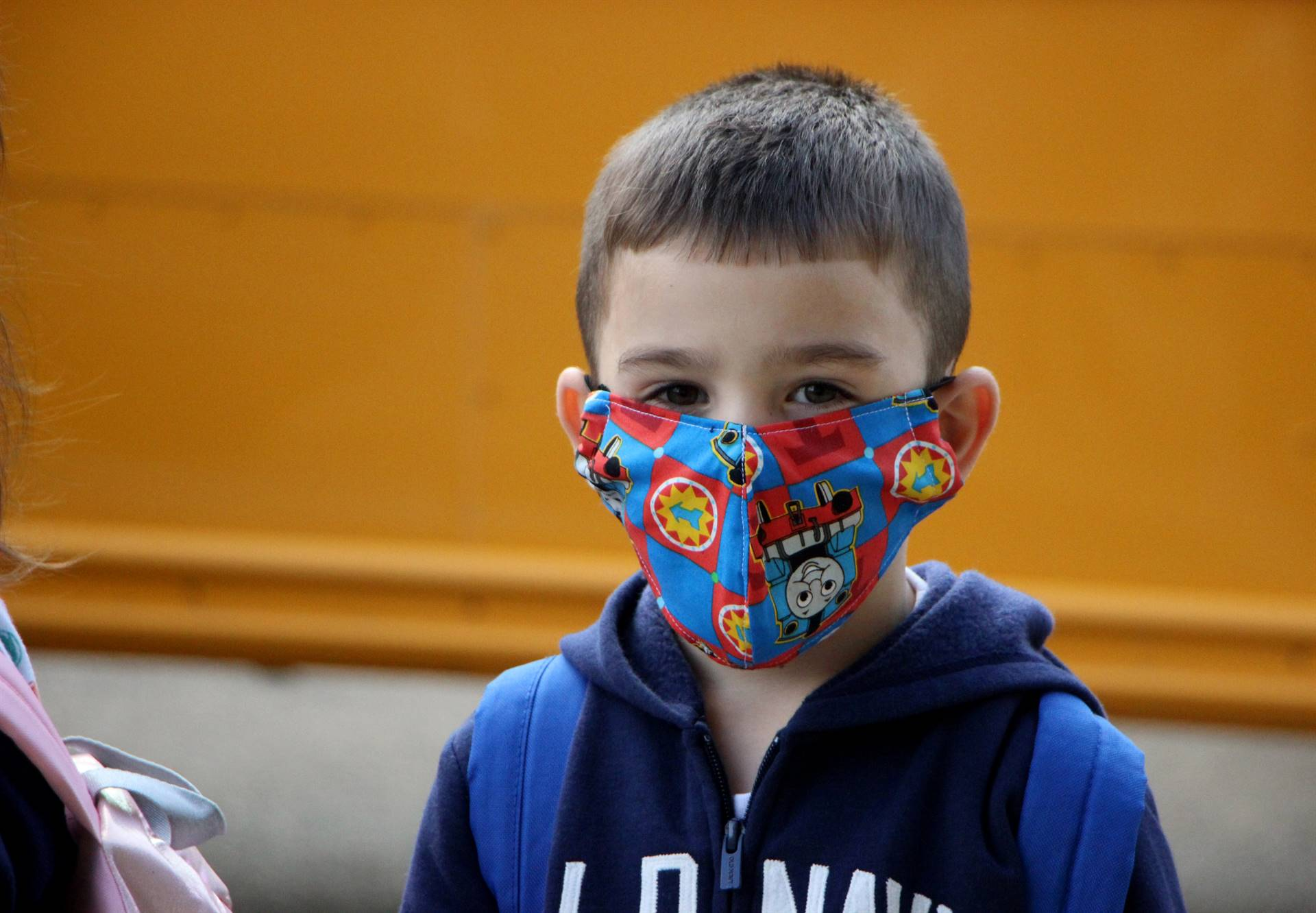 boy in facemask outside