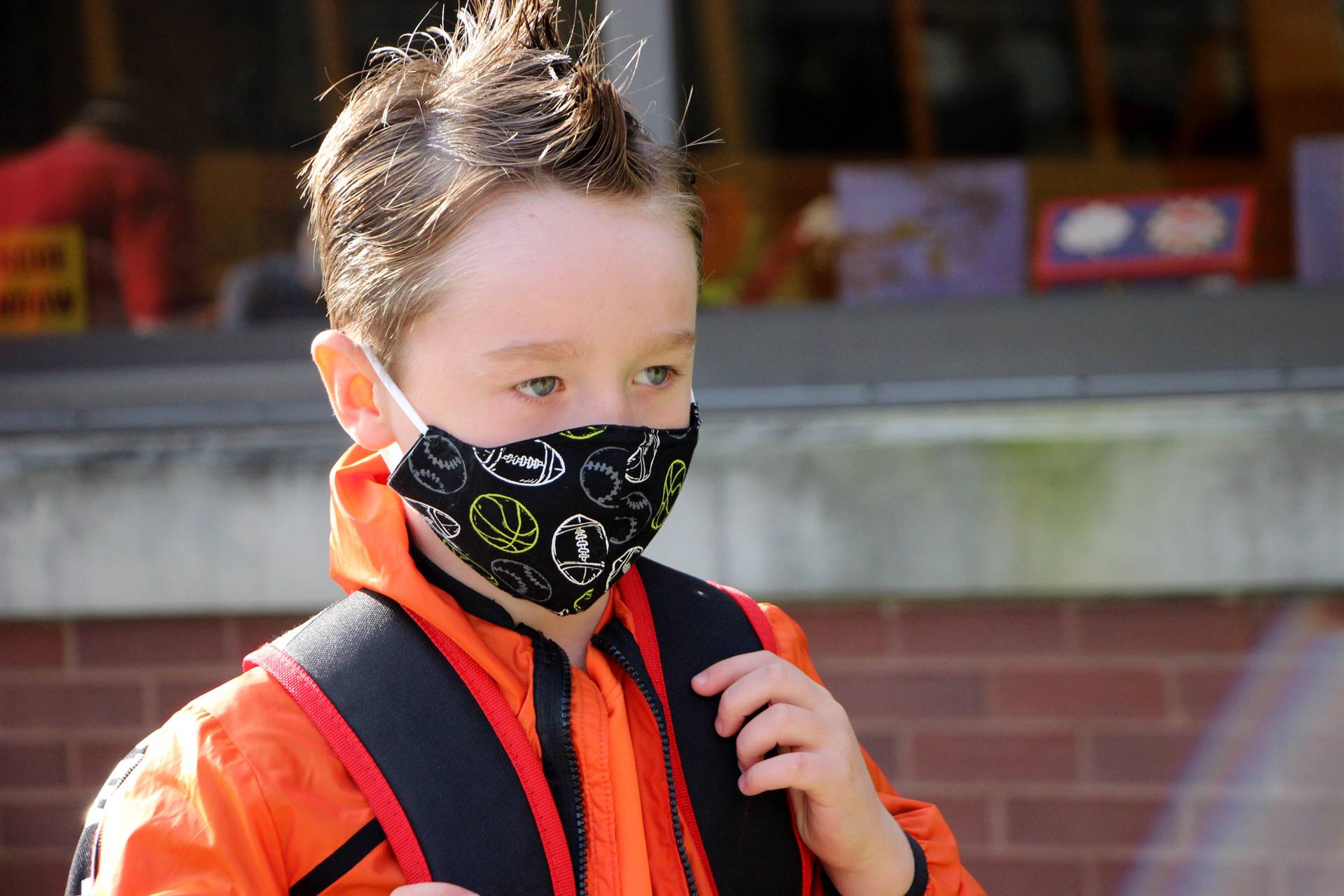 boy in mask outside