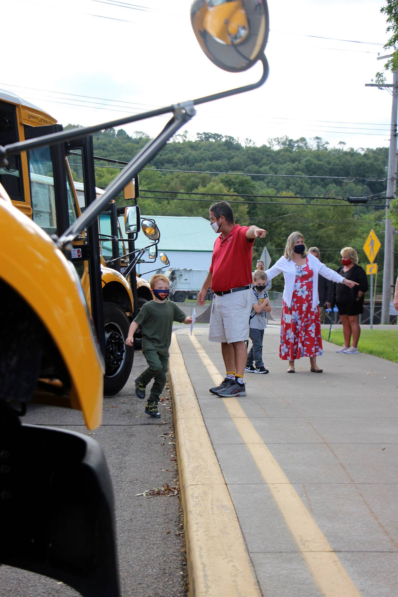 boy gets off of school bus