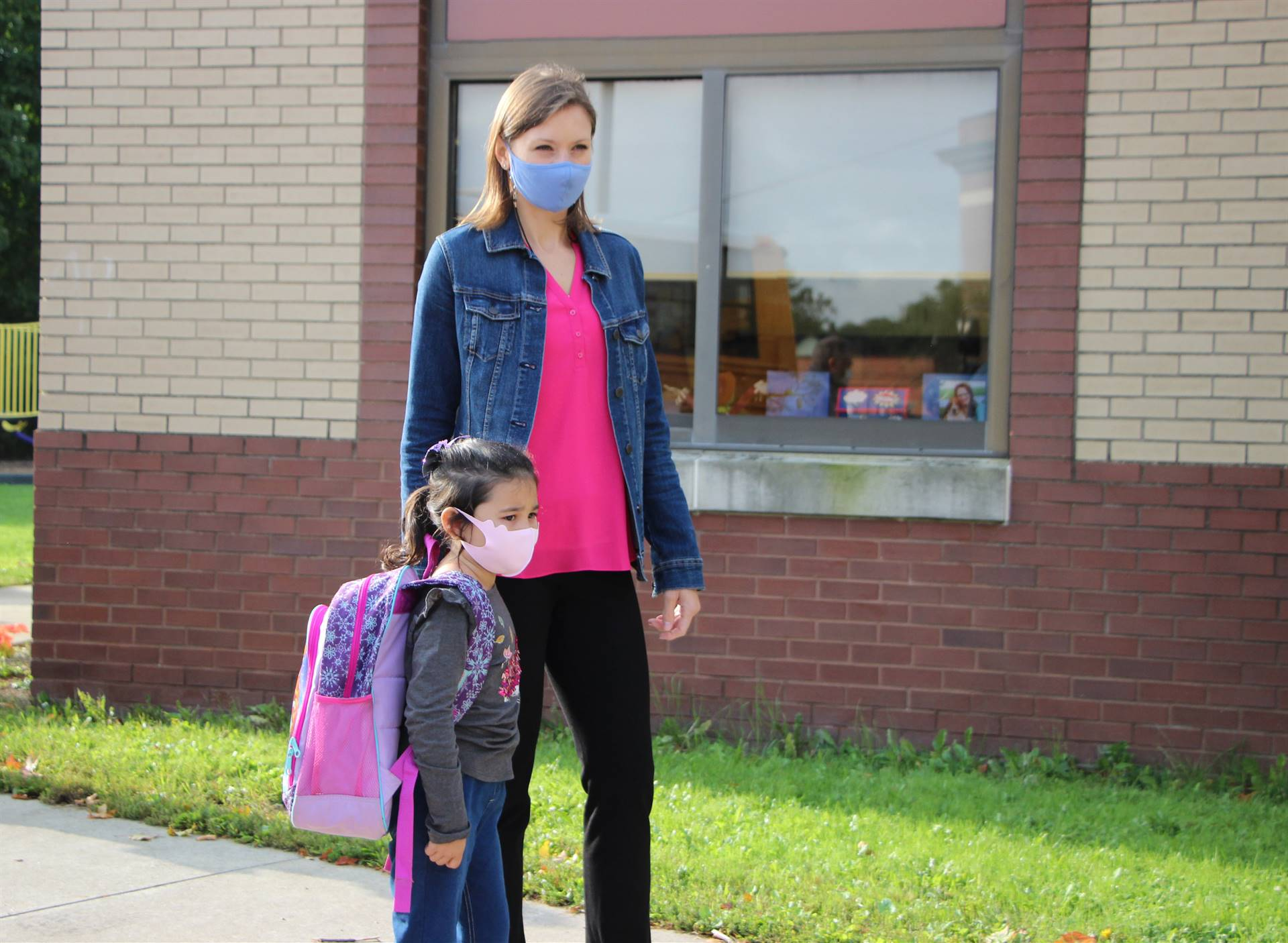 Teacher and student outside in facemasks