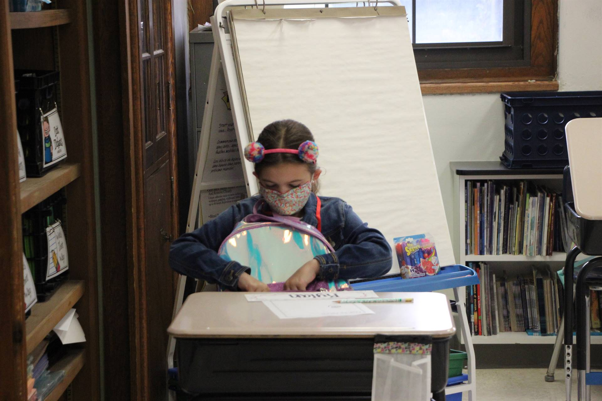 girl at desk in classroom
