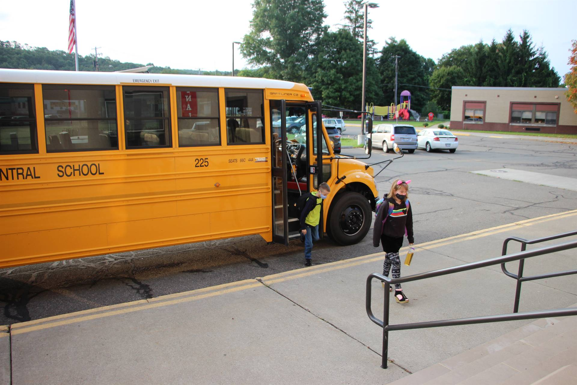 students getting off of school bus