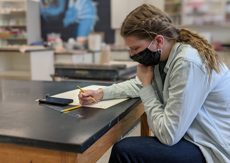 Student wearing mask taking a test
