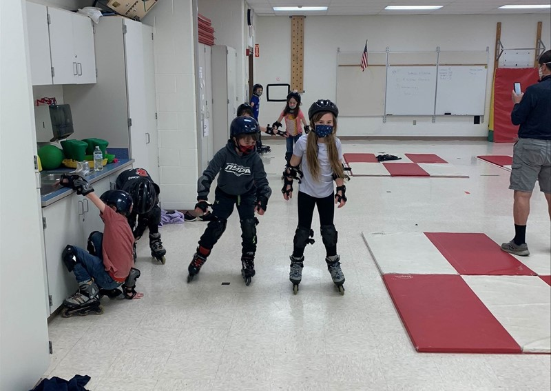 NTH Elementary students rollerblading in classroom