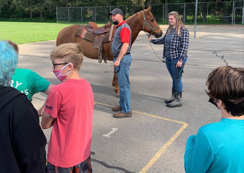 Students outside with horse